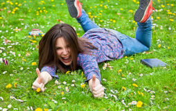 Cute teenage girl relaxing in spring park Royalty Free Stock Photo