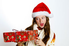 Cute teenage girl in santa red hat with gift box Royalty Free Stock Image
