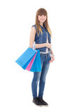 Cute teenage girl with shopping bags isolated on white Stock Photo