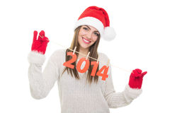 Cute teenage girl showing New Year number decoration Royalty Free Stock Photography