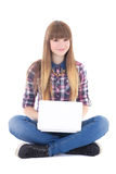 Cute teenage girl sitting with laptop isolated on white Stock Images