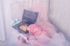 Cute teenage girl is sleeping sweetly in a Christmas Royalty Free Stock Images