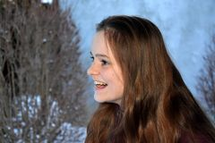 Cute teenage girl smiles with malicious joy stock photography