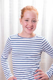 Cute teenage girl smiling self confident into the camera Royalty Free Stock Image