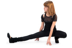 Cute teenage girl stretching Royalty Free Stock Photos