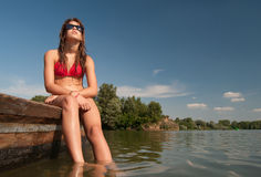 Cute teenage girl sunbathing on the boat Stock Photo