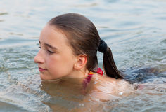 Cute teenage girl swimming in the river Royalty Free Stock Photos