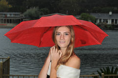 Cute teenage girl under red umbrella Stock Photo