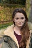 Cute teenage girl with winter jacket stock photo