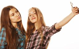 Cute teenage girls making selfie isolated Stock Photo