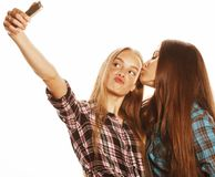 Cute teenage girls making selfie isolated Stock Image