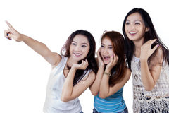 Cute teenage girls pointing copyspace Royalty Free Stock Photos