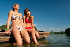 Cute teenage girls sunbathing on the boat Stock Images