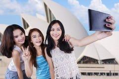 Cute teenage girls taking self portrait Stock Photo