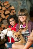 Cute teenage girls with their dogs. Royalty Free Stock Images
