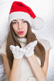 Cute teenage Santa girl blowing kiss Stock Photos