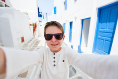 Cute teenage tourist making selfie in Greece Royalty Free Stock Photography
