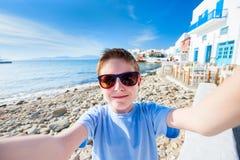 Cute teenage tourist making selfie Stock Photos