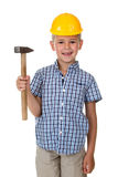 Cute teenager boy in blue checkered shirt and yellow building helmet, holding a hammer on white isolated background Royalty Free Stock Photography
