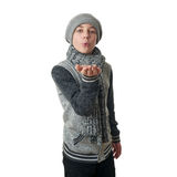 Cute teenager boy in gray sweater over white isolated background. Cute teenager boy in gray sweater, hat and scarf blowing on hands over white isolated Royalty Free Stock Photo