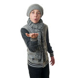 Cute teenager boy in gray sweater over white isolated background. Cute teenager boy in gray sweater, hat and scarf blowing on hands over white isolated Stock Photography