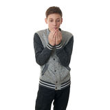 Cute teenager boy in gray sweater over white isolated background. Cute teenager boy in gray sweater heating hands over white isolated background, half body Stock Images