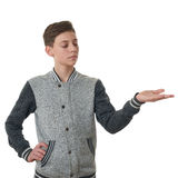 Cute teenager boy in gray sweater over white isolated background Royalty Free Stock Image
