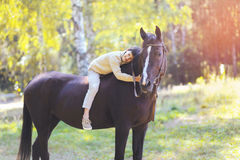 Cute teenager boy and horse Stock Image