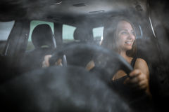 Cute teenager driving her new car Stock Photography