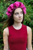 Cute teenager girl with a beautiful wreath on her head. Cute teenager girl in a park with a beautiful wreath on her head Royalty Free Stock Photo