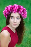 Cute teenager girl with a beautiful wreath on her head. Cute teenager girl in a park with a beautiful wreath on her head Stock Photo