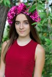 Cute teenager girl with a beautiful wreath on her head. Cute teenager girl in a park with a beautiful wreath on her head Stock Photography