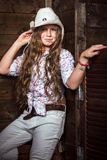 Cute teenager girl in a cowboy hat Royalty Free Stock Image