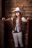 Cute teenager girl in a cowboy hat Stock Photos