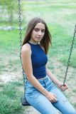 Cute teenager girl with long and straight hair. Outside royalty free stock image