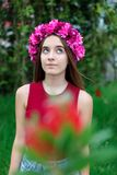 Cute teenager girl with a beautiful wreath on her head. Cute teenager girl in a park with a beautiful wreath on her head Stock Images