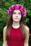Cute teenager girl with a beautiful wreath on her head. Cute teenager girl in a park with a beautiful wreath on her head Royalty Free Stock Image