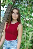 Cute teenager girl in a park Royalty Free Stock Image