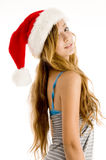 Cute teenager girl wearing christmas hat. Side pose of cute teenager girl wearing christmas hat on an isolated white background Stock Photos