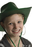 Cute teenager with green cowboy hat. A cute  smiling teenage girl with a green cowboy hat Royalty Free Stock Image