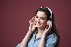 Cute teenager with headphones Stock Images