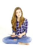 Cute teenager holding tablet looking camera isolated Royalty Free Stock Photography