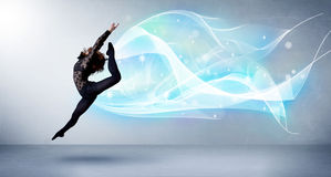 Cute teenager jumping with abstract blue scarf around her Stock Photos