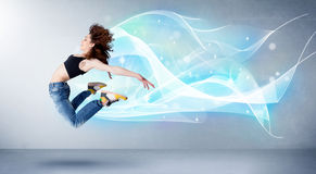 Cute teenager jumping with abstract blue scarf around her Stock Images