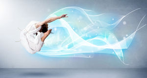 Cute teenager jumping with abstract blue scarf around her Stock Image
