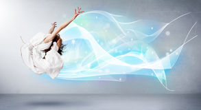 Cute teenager jumping with abstract blue scarf around her Royalty Free Stock Photos