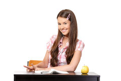 Cute teenager listening music in school Stock Images