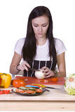 Cute Teenager Preparing Food Stock Images