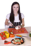 Cute Teenager Preparing Food Stock Photos