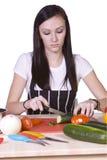 Cute Teenager Preparing Food. Cute Teenager in the Kitchen Preparing Food Royalty Free Stock Image